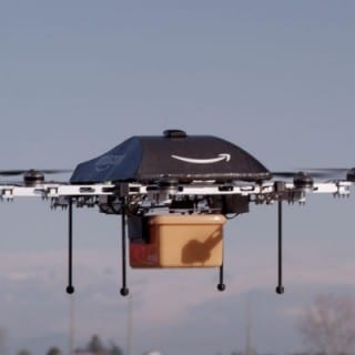 drone in flight delivering Amazon Prime products