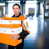 tnt employee holding branded packages