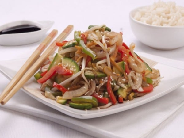 a typical Chop Suey dish, plated, with chopsticks