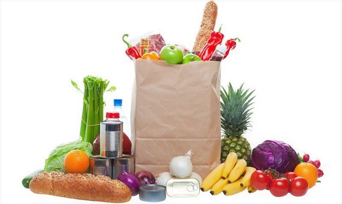 a large paper bag full of groceries