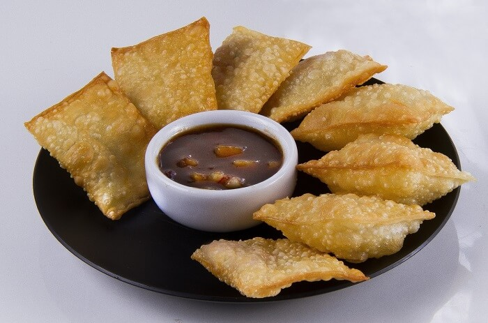asian dish with deep fried slices with sauce in the middle of the plate