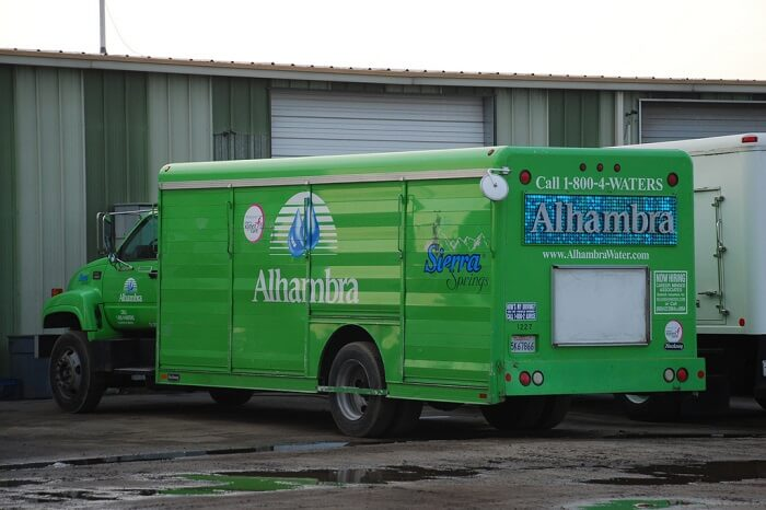 Alhambra delivery truck in front of a home