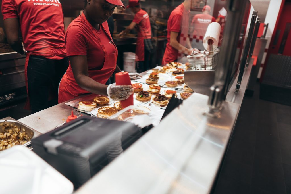 Woman preparing food on Five Guys