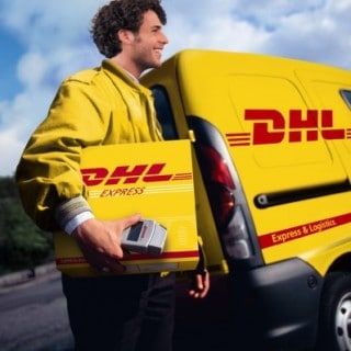 DHL staff member in front of branded truck with package in tow