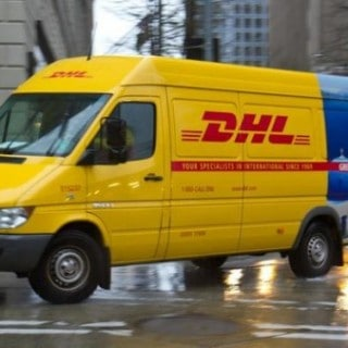 van in DHL brand colors yellow and red