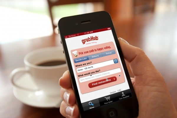 shot of hand holding smartphone with food delivery app grubhub open