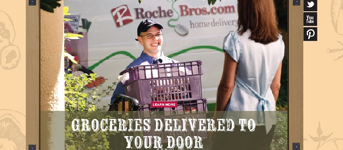 a young man delivering groceries to a client with the Roche Brothers logo in the background