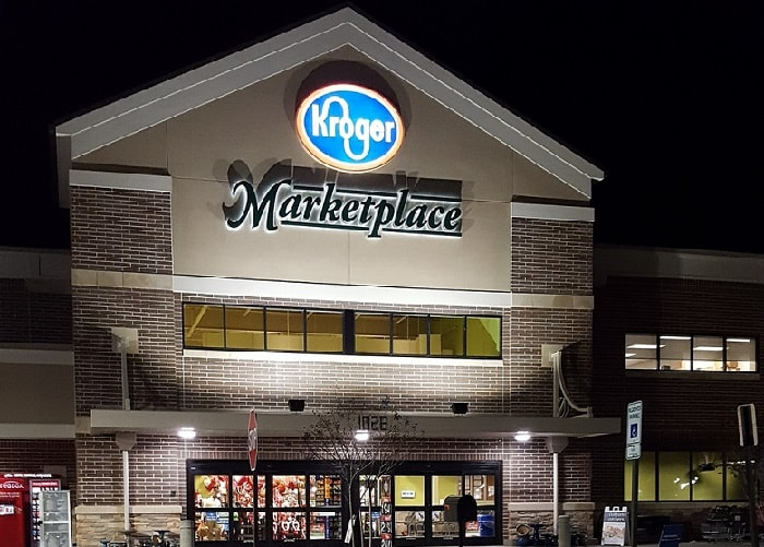 the front side of a Kroger marketplace at night time
