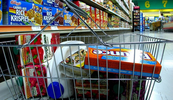 a shopping cart full of groceries close-up
