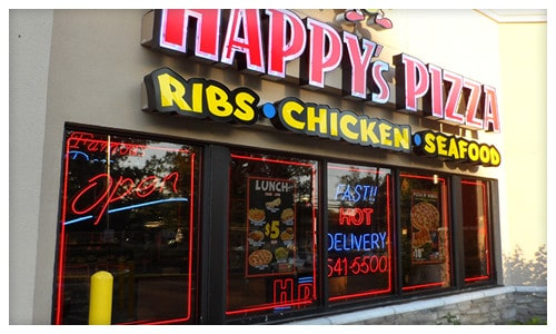 opened happys pizza restaurant with posters on doors and windows