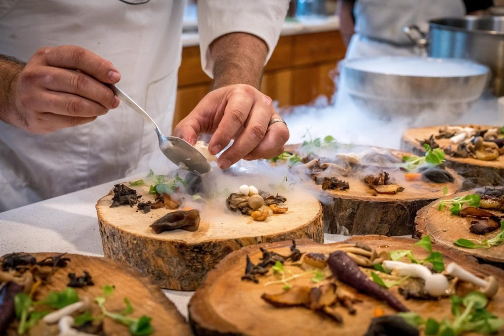 Chef preparing food on a wood plank